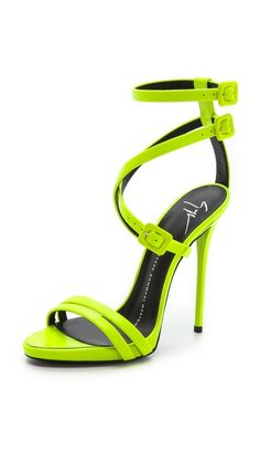 Giuseppe Zanotti Neon Crisscross Sandals MOST AMAZING SHOES EVER ! UNFORTUNATELY THESE SHOES RUN SMALL AND THAT WASNT MENTIONED IN THE DESCRIPTION, SO IF YOU DO LOOK TO BUY THEM ORDER HALF A SIZE UP FROM YOUR NORMAL SIZE