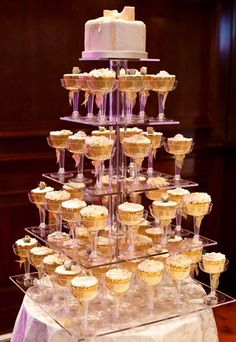 Cupcake cake - 20 amazing alternative wedding cake ideas - Ah the classic cupcake cake, we haven't forgotten it. Although this has been slightly done to death, the cupcake cake is still a major win for your wedding day. Who doesn't like cupcakes. Alternative Wedding Cakes, Wedding Cake Alternatives, Gatsby Party, Gatsby Wedding, Party Wedding, Wedding Cakes With Cupcakes, Cupcake Cakes, Wedding Cupcakes Display, Tiffany Cupcakes
