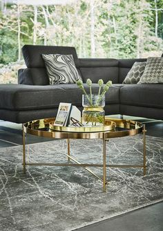 Less is more when it comes to the Simple Form trend. The clean and simple lines of high shine metal furniture is juxtaposed by touches of patterned decor which adds depth to the look. Get the look with the Genesis Coffee Table, which features a luxe gold finish and a mid century-inspired shape; click to shop.