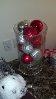 Ornaments in hurricane for Christmas decor