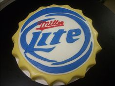 """MILLER LITE BOTTLE CAP Cake, carved from 12"""" round cake, covered in fondant. By LuLu at LuLu's Sweet Expectations, Phenix City, AL"""