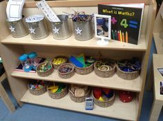 Maths resource shelf for children to help themselves to what they want to use, encouraging independence. All resources are changed half termly according to what the current needs of the children are. #abcdoes #eyfsmaths #eyfs