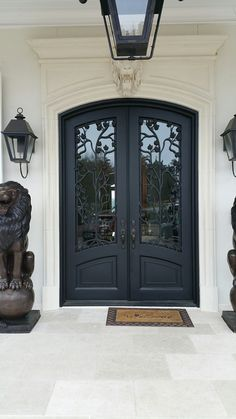 Here's another recent install. We absolutely love the way the white exterior pops against this gorgeous wrought iron door! exterior doors. front doors. entry door. iron door. remodel. custom home. design. luxury home. dream home. homebuilders.