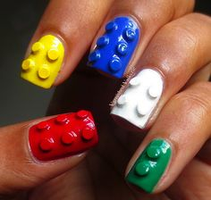 3D Lego nails! Done by stacking 3 pieces of circular glitter, then painting over them with acrylic paint.