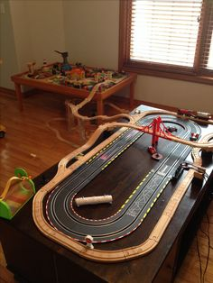 Wooden train track around race track
