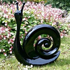 black snail garden art