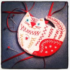 Learn to stitch this cute cat http://hoophaberdashery.co.uk/event/deck-the-halls-with-nancy-nicholson-cat/