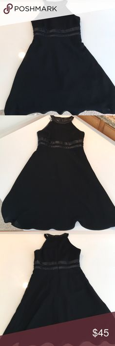 """Beautiful Beaded Black Cocktail Dress Purchased from Macy's. Has beaded neckline and empire waist. Slight yoke neck and """"racer back"""" makes it unique. Very flattering silhouette: fitted on top with a flowy skirted bottom. Some beading is lose and missing in back, but it's not noticeable while and the dress is still in great condition. Brand is Evan Picone, Size is 4P. Evan Picone Dresses"""