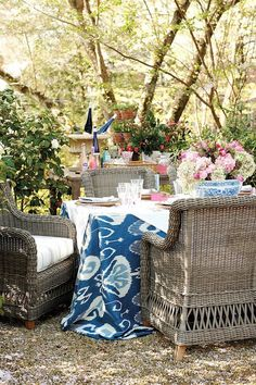 An oversized tablecloth with sturdy wicker furniture take this outdoor setup from plain to beautiful.  See more from Danielle D. Rollins »   - HouseBeautiful.com