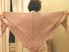 Wool Peddler's Shawl by Cheryl Oberle  Published in Folk Shawls. The Wool Peddler's shawl is triangular, worked from the top down in garter stitch to a traditional lace pattern with a garter-stitch border.