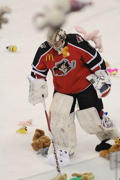 Portland goaltender Justin Pogge skates off the ice after the Hershey Bears scored a goal and teddy bears rained onto the ice for Teddy Bears Toss night.