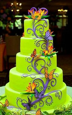 Lime green, whimsical cake with purple vine and butterflies!
