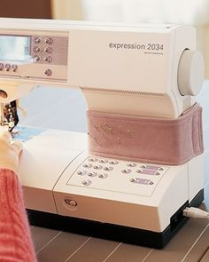 A wraparound pincushion that fastens onto your sewing machine keeps pins in place and at your finger tips.