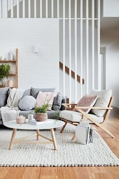 If you want a Scandinavian living room design, there are some things that you should consider and implement for this interior style. Wood as a material has an important role as well as light colors, because they give the living… Continue Reading → Living Room Interior, Home Living Room, Home Interior Design, Living Room Designs, Living Room Decor, Scandinavian Interior Living Room, Living Room With Grey Sofa, Living Room With Stairs, Living Area