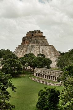 """The Pyramid of the Magician"" in Uxmal, Mexico, is a Maya structure (built in its present form between the eighth century and ninth) extensively rediscovered in the 1840s, four-hundred-years after the Spanish conquest of the Yucatán. A quintessential example of Mayan architecture, the pyramid stands on a complex of temples and courts--Ball Game Court, Nunnery Quadrangle, et al--It's designated a UNESCO World Heritage Site."