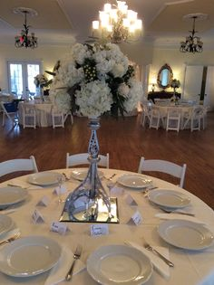 White centerpieces by Flowers by On at Thompson House and Gardens