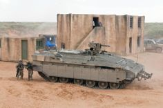 "Namer in U.S. military trials.  Namer (Hebrew: נמ""ר‎, pronounced [nameʁ], means ""leopard"" and also a syllabic abbreviation of ""Nagmash"" (APC) and ""Merkava"" is an Israeli armored personnel carrier based on a Merkava tank chassis."
