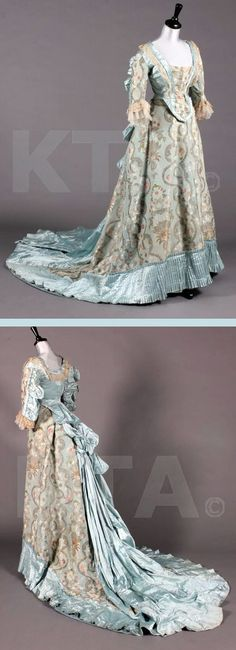 ~1890s fancy dress gown, ice blue brocaded satin. A 1730s bodice with deep curved front waist, cut high at the back with short tails, and ruffled and gathered blue satin outside sleeves. The front skirt is entirely of 18th century brocade, pleated blue satin band to hem, long blue satin train to rear skirt. Kerry Taylor Auctions~