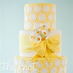 Wedding Cakes Happy, pretty daisy cake from Wild Orchid Baking Company, in beautiful (snowy) New Hampshire. - A cheerful yellow wedding cake covered in sugar daisies. Daisy Wedding Cakes, Daisy Cakes, Beautiful Wedding Cakes, Beautiful Cakes, Amazing Cakes, Cake Wedding, Ribbon Wedding, Perfect Wedding, Pretty Cakes