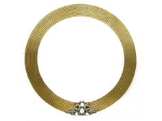 22 karat gold wide mesh choker. Clasp with filigree, emeralds, and diamond Peacock adornments, from Karni Jewellers.