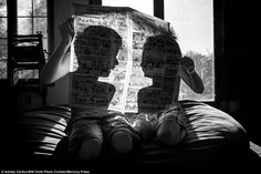 Contrast: The photographers use light for effect and these silhouettes in a photo by Ashley Carlton, called A Pair Of Children Reading A Comic, contribute to this striking image of two children behind a newspaper