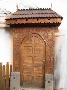 """Place: oroszhegy in transylvania.  Carved gate with an ancient form of writing """"rovas"""""""