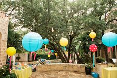 get fishing line, attach to different ends of the garden and add the lanterns- outdoor decorations done!