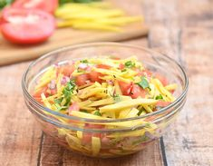 Filipino Mango and Tomato Salad is a refreshing combination of crisp mangoes, plump tomatoes, onions and cilantro tossed in a vinegar and fish sauce dressing