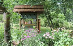 Because I love thatch, doves and bees... we built this. Dovecote/ bee haven