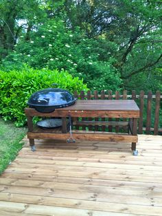 Weber Ranch Kettle Grill Table - I made it using wood from an old sauna. The wood has been triple stained. It's 2m long and very easy to move around.