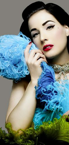 Dita Von Teese - love the blues and the greens against the white of her skin.