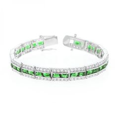 Bracelets White Gold Rhodium Bonded 7.25 Inch Bracelet with Three Rows of Radiant Green and Round Cut Clear Cubic Zirconia in a Channel Setting and a Box Clasp in Silvertone. Fashioned in luminescent silver tone and three rows of assorted shimmer our Emerald Tennis Bracelet lends sassy tones to classic refinement. White Gold Rhodium Bond is achieved using an electroplating process that coats the item with heavy layers of rhodium a close cousin of platinum that costs three times as much which…