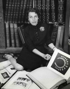 """Joan is pictured in the Joseff library in 1937, wearing a Joseff sun brooch. The necklace shown in the book was replicated for Norma Shearer in 1938's """"Marie Antoinette."""""""