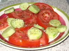 Tomato and Cucumber Salad (Greek)- - 4 ripe tomatoes 2 large cucumbers 0live oil oregano Vinegar Salt