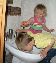 The Mason kids were tickled to find their hotel room came with this handy drinking fountain that was just their size.