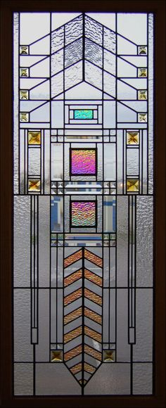 Frank Loyd Wright style stained glass window from the Chuck Franklin Glass Studio. Frank Loyd Wright incorporated stained glass windows/doors into his spaces...why? For the MAGIC! The play of light! The energy it gives you! The beauty it brings to your soul!