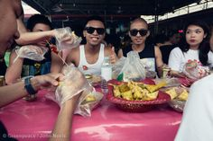 Teenagers Enjoying Traditional Street Food at Sinulog Festival in Cebu City, Philippines. Sinulog festival is a religious celebration attended by 3 million people from the Philippines and all over the world. The celebration lasts for nine days with street dances and performances. Street food plays an important role with local delicacies being served at the festival.