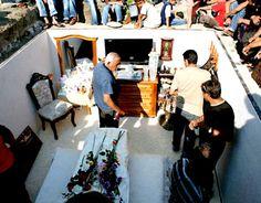 """Jardines de Humaya, Culiacan, Sinaloa  Narco Cemetery    """"Si los narcos ejercitan sus creencias con el gozo de la insensatez, como dijo en una conferencia a fines de enero del 2008 Carlos Monsiváis, matar entonces se convierte en una forma de dialogar con la realidad."""""""