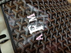 Goyard Paris. Pick your bag ,monogram and color. A St. Louis for me with a pink and grey monogram .oh la la!
