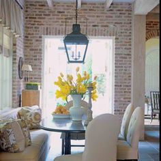 Breakfast nook with brick accent wall