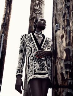 Ajak Deng and photographer Julia Noni hit one out of the ballpark in this latest work for French publication Obsession Magazine. Ajak wears looks including Chanel, Balmain, Prada, and Balenciaga with techno chic accessories styled by fashion editor Barbara Loison. The futuristic editorial statement makes a dramatic and original visual impression. Love, love.