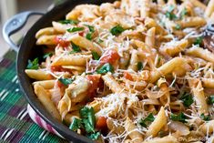 Penne with Artichokes:  1 small onion, finely sliced  1/4 cup extra virgin olive oil  5 artichoke hearts, finely sliced  1 tablespoon capers  1 1/4 cups canned diced tomatoes  1 lb. penne rigate  1 tablespoon chopped parsley  1/2 cup grated Parmesan cheese