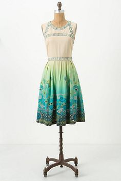 The bodice isn't really me with that very high neckline, but I love the combination of ombre and the border print in the skirt. Now where can I get fabric like this !