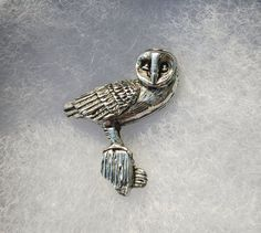 perfect for a sea bird lover as a gift handmade by SJH Designs in Scotland Puffin bird brooch pin standing on a rock