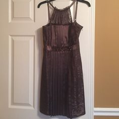 ONLY WORN ONCE dark taupe dress Lace top and side panels with silk pleats in middle. Has small beaded detail at waist. Halter. Perfect condition. Falls right above the knee BCBGMaxAzria Dresses Prom