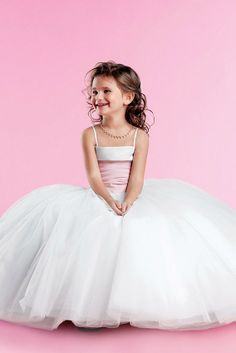 Eden 12229S Flower Girl Dress Square neckline tops off this Matte Satin & Tulle gown The bodice has pleated satin to the dropped waistline The floor length ball gown skirt is made of tulle #timelesstreasure