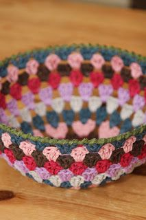 Granny square doilies turned into bowls. Put in hot sugar water, place on a plastic/glass bowl turned upside down and let it dry. An alternative: starch solution (water + cornstarch).