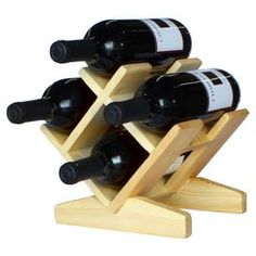 Stow your favorite vintages and special-occasion bubbly in this pine wood wine rack, showcasing a beautiful crisscross design. Product: Wine rackConstruction Material: PineColor: NaturalFeatures: HandcraftedHolds four bottles of wine Dimensions: H x W x D Wood Wine Racks, Wine Glass Holder, Wine Bottle Holders, Horseshoe Wine Rack, Wood Log Crafts, Wine Rack Design, Woodworking Projects That Sell, Woodworking Videos, Small Wood Projects