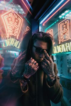 character, male, white, brown hair, long hair, sunglasses, tattoos, piercings, rings, neon