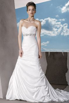 Demetrios - Sensualle. Strapless satin dress with a ruched sweetheart neckline and lace-up back. Beaded belt highlights empire bodice. Trumpet skirt features side pick-up with jeweled motif and bubble hem.